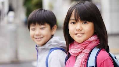A Japanese boy and girl smiling
